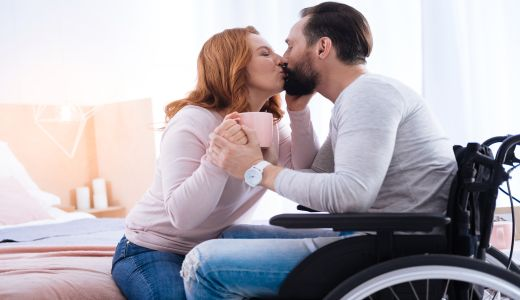 couplekissingmaninwheelchairresized520x300